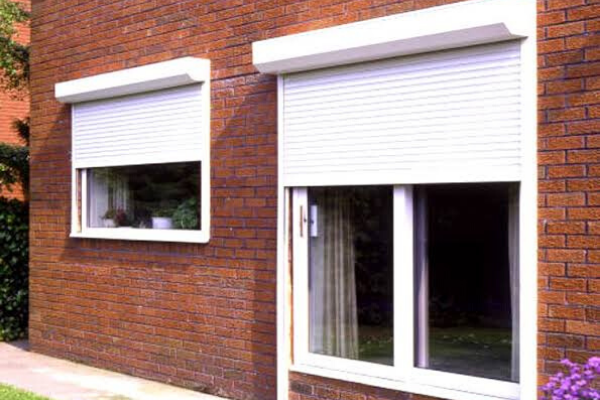 The Brick Wall And Two Windows With PVC Rolling Shutters For Best soundproofing Shutter For Your Home.